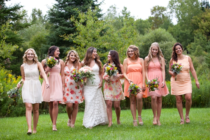 I was very laid back with our bridal party. I let all my girls pick their own dresses in the peach family and I wanted my two sisters/MOH to wear a floral peachy print. I asked them to get nude wedges and let them wear their hair and makeup however they please. Turned out just as I hoped it would!